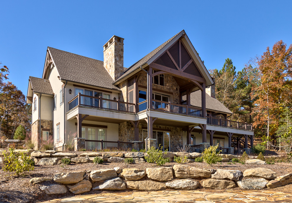 Example of a mountain style two-story exterior home design in Other