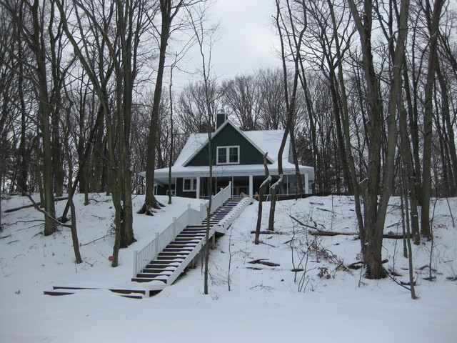 Lakeshore cottage in winter traditional-exterior