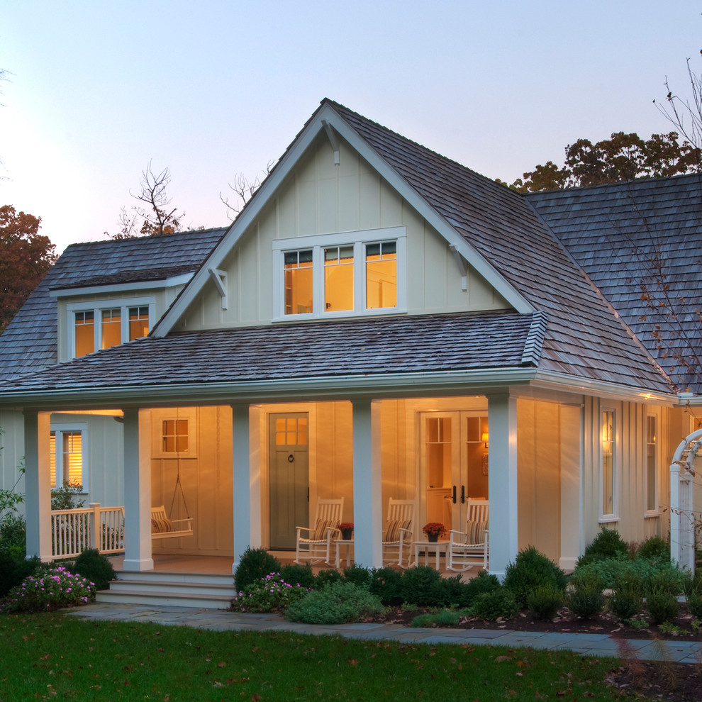 Inspiration for a coastal yellow two-story gable roof remodel in DC Metro