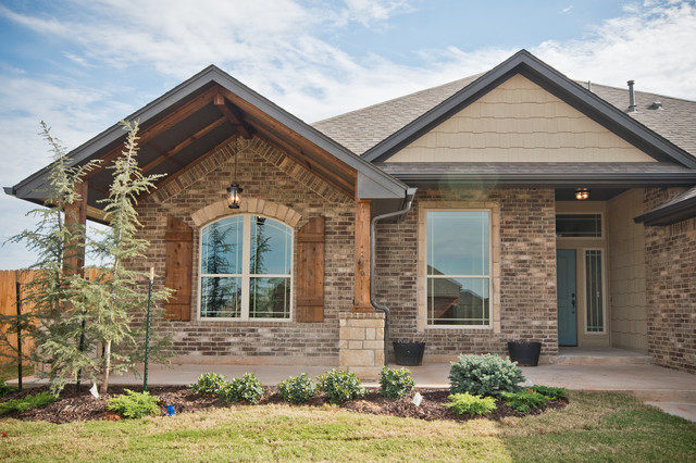 Large Front Porch With Brick And Stone Accents Traditional Exterior Oklahoma City By