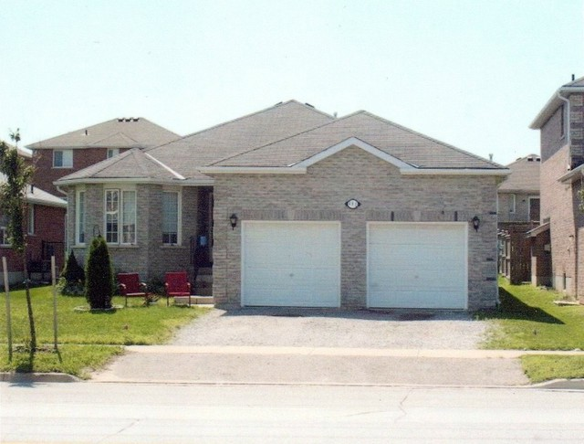 Largest bungalow in barrie ontario traditional for Exterior by design ottawa