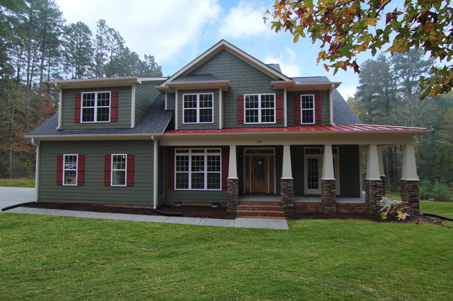 Le chalet vert traditional exterior raleigh by for Metal roof craftsman home