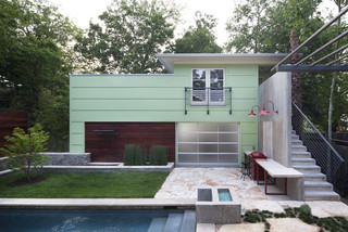 Contemporary small house exterior design with small pool.