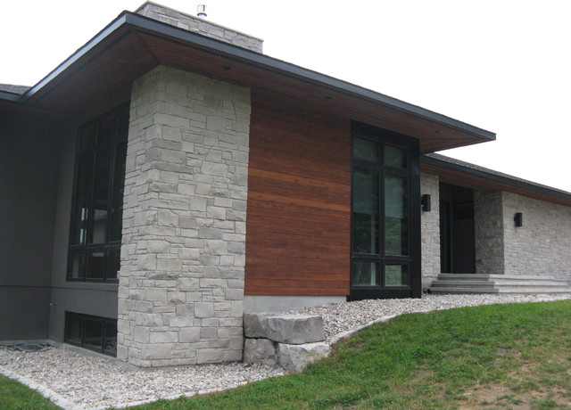Ledgerock stone house with stucco and cedar for Modern stucco house