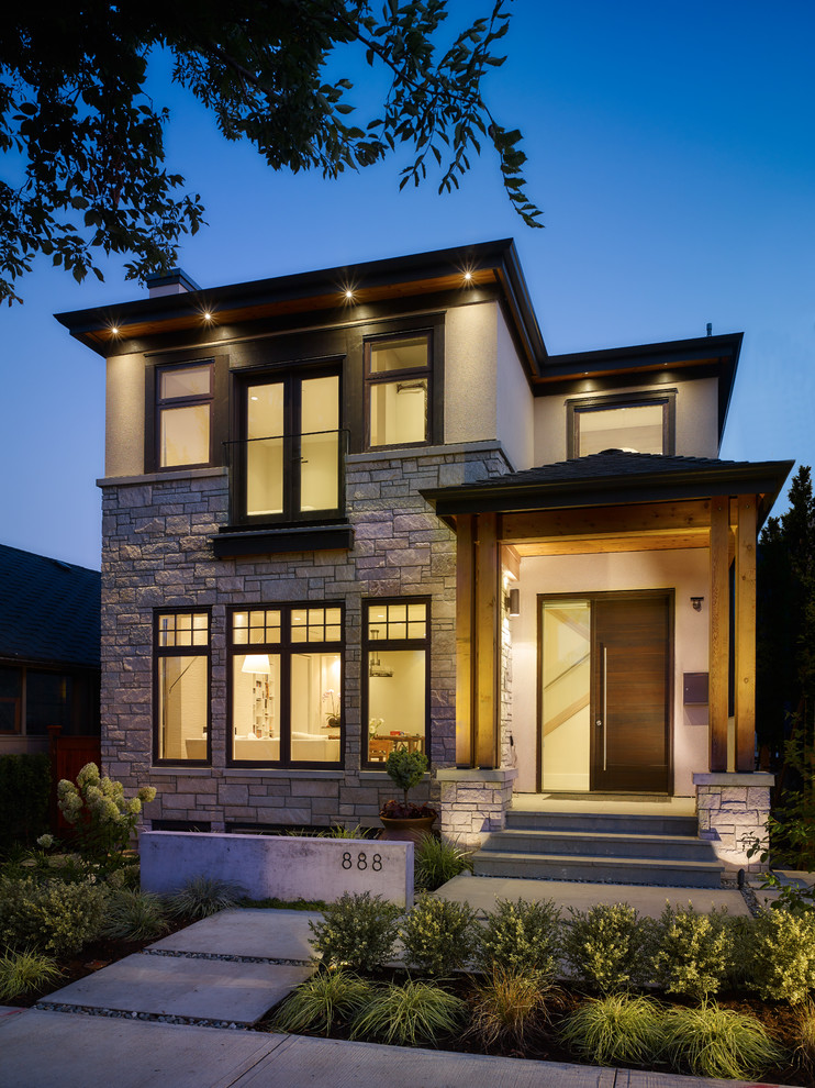 Inspiration for a small contemporary two-story mixed siding exterior home remodel in Vancouver