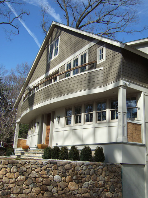 Example of an arts and crafts exterior home design in New York