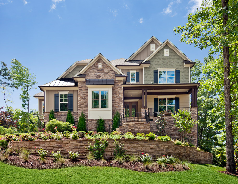 Example of a classic brick exterior home design in Raleigh
