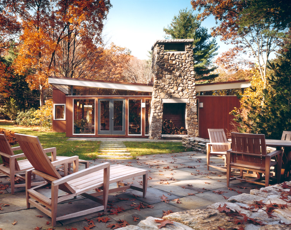 Inspiration for a mid-sized modern brown one-story wood flat roof remodel in Boston