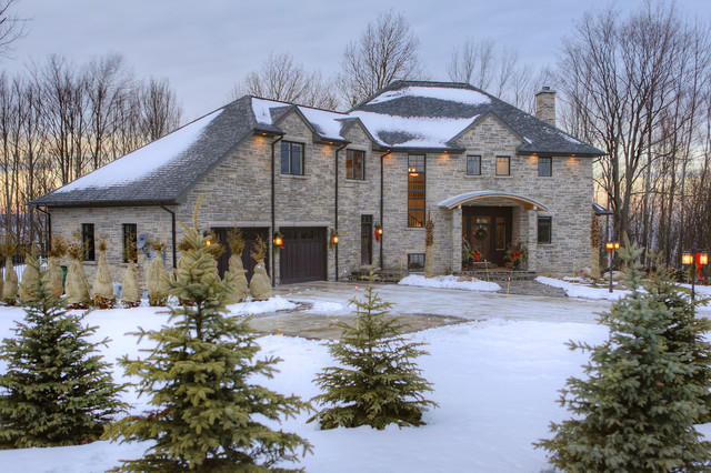 Limestone Home in the Winter traditional-exterior