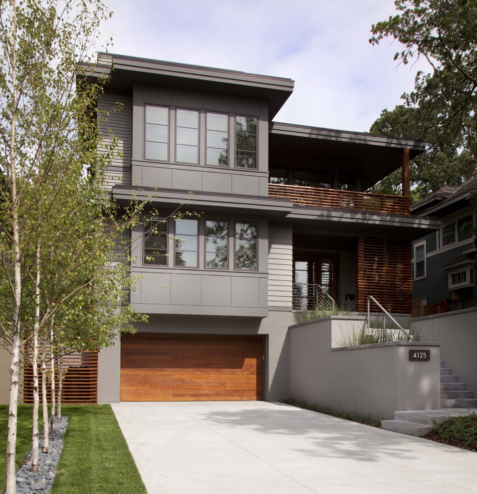 Contemporary two-story exterior home idea in Minneapolis