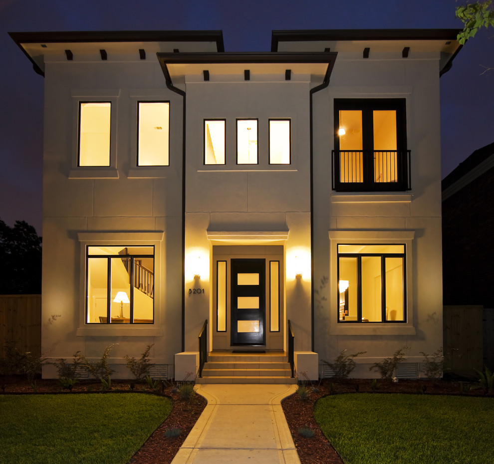 Inspiration for a contemporary beige two-story concrete flat roof remodel in Houston