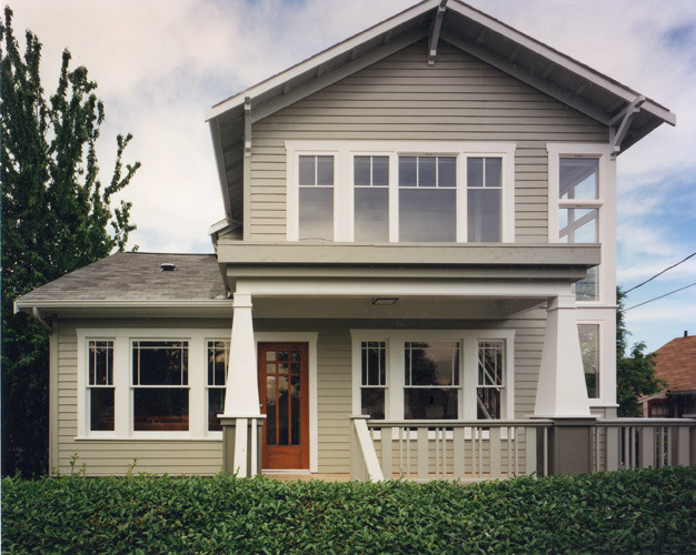 Inspiration for a large craftsman beige three-story house exterior remodel in Seattle