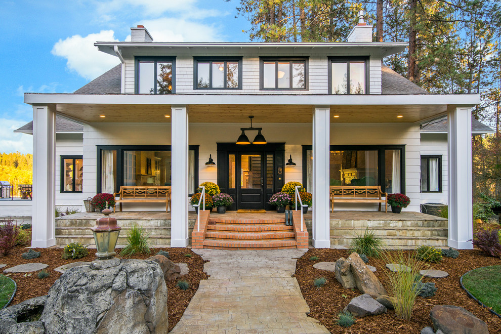Example of a farmhouse exterior home design in Seattle