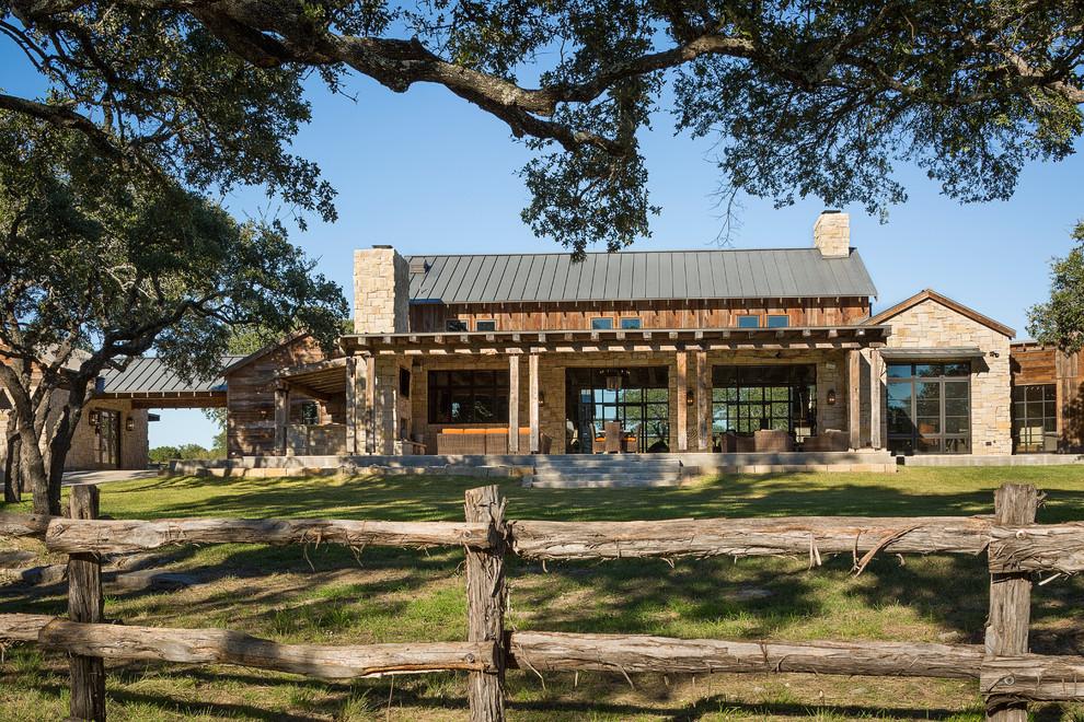 Rustic mixed siding exterior home idea in Austin