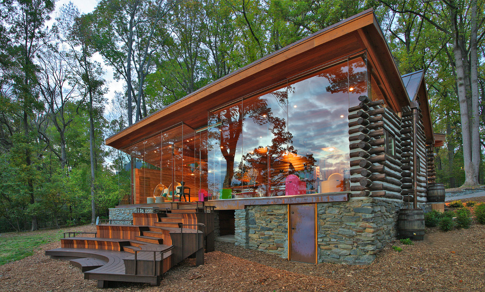 Large rustic brown two-story glass house exterior idea in DC Metro with a shed roof and a metal roof