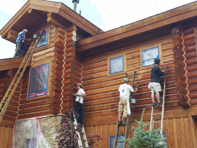 Log home maintenance staining log home rustic exterior How to stain log cabin