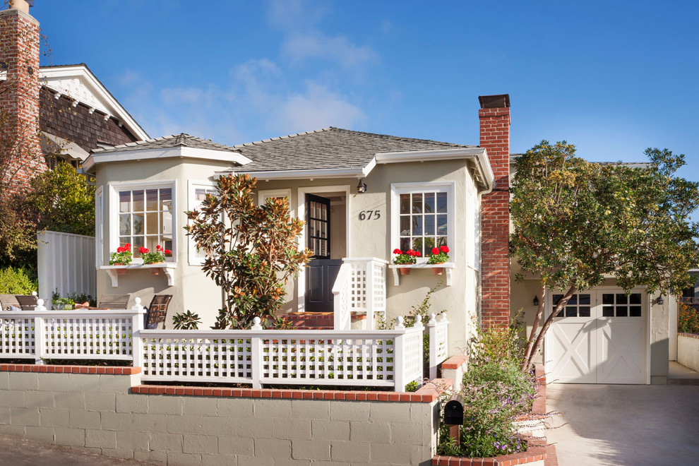 Small beach style beige one-story exterior home photo in Orange County with a hip roof