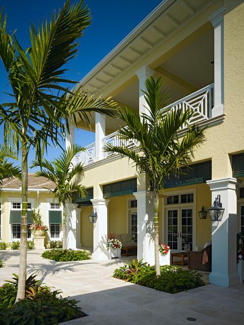 London Bay Custom Home at Grey Oaks tropical-exterior