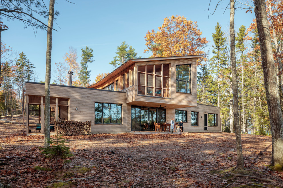 Mountain style brown two-story wood house exterior photo in Portland Maine with a shed roof