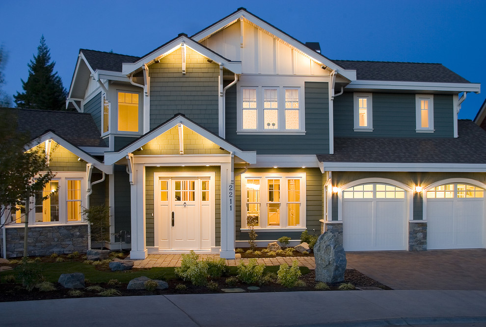 Mid-sized elegant three-story wood exterior home photo in Vancouver