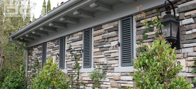 Louver Style Shutters for a French Chateau Style Home in Newport