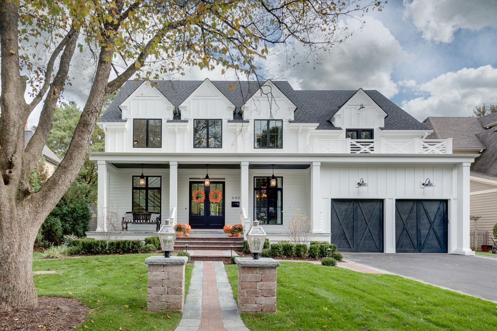 Inspiration for a large farmhouse white two-story wood exterior home remodel in Chicago with a shingle roof