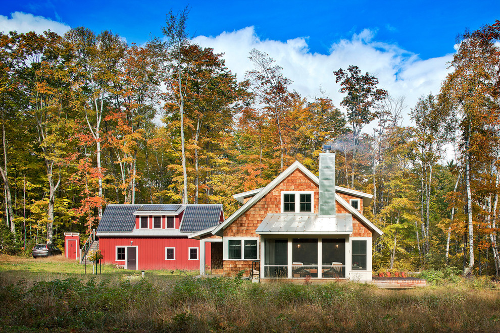 Mid-sized farmhouse red two-story wood gable roof photo in Minneapolis