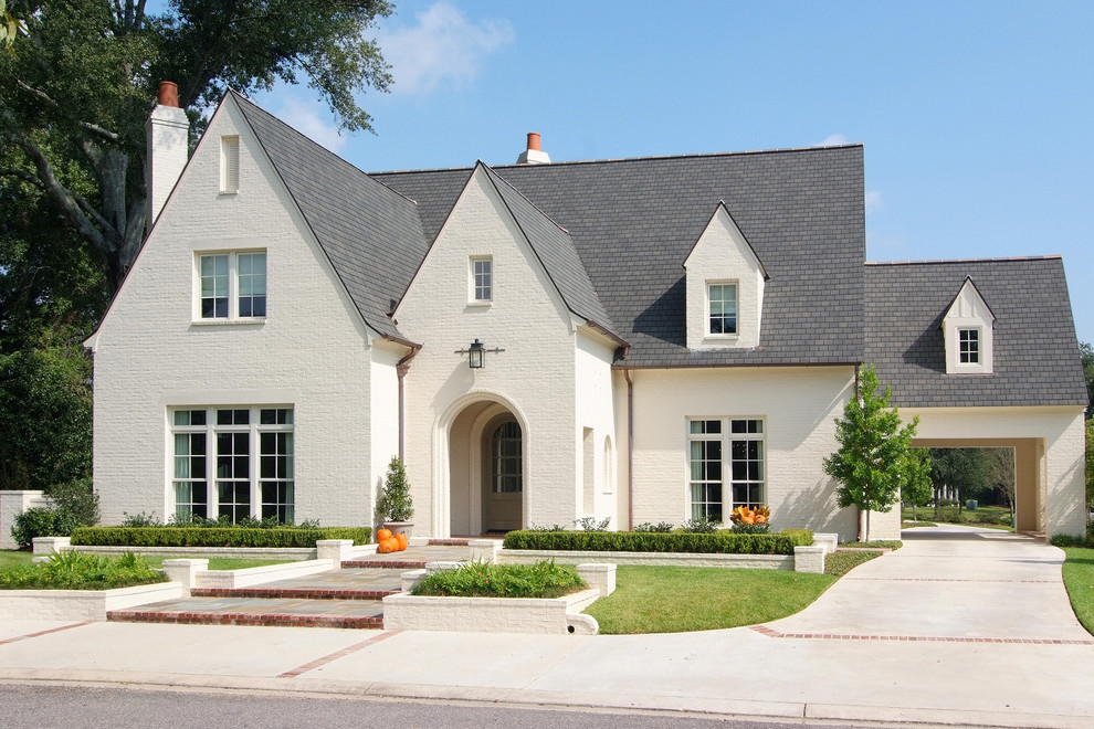 Example of a large classic two-story brick gable roof design in New Orleans