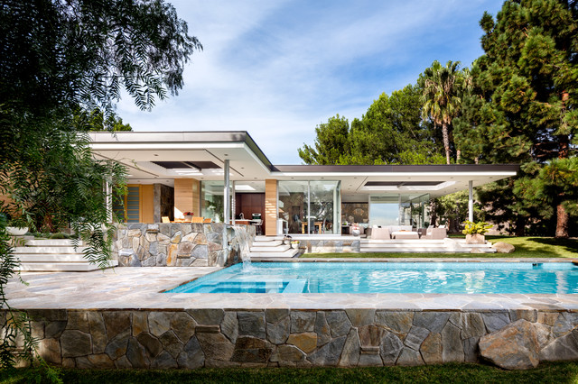 Inspiration for a large contemporary multicolored one-story glass exterior home remodel in Los Angeles