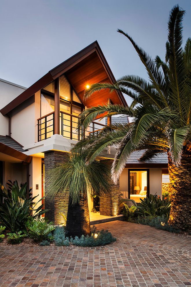 Example of a trendy beige two-story exterior home design in Perth