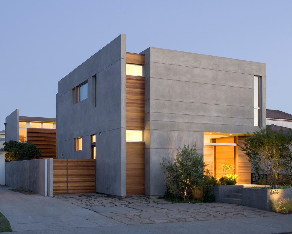 Mid-sized minimalist gray two-story stucco exterior home photo in Los Angeles