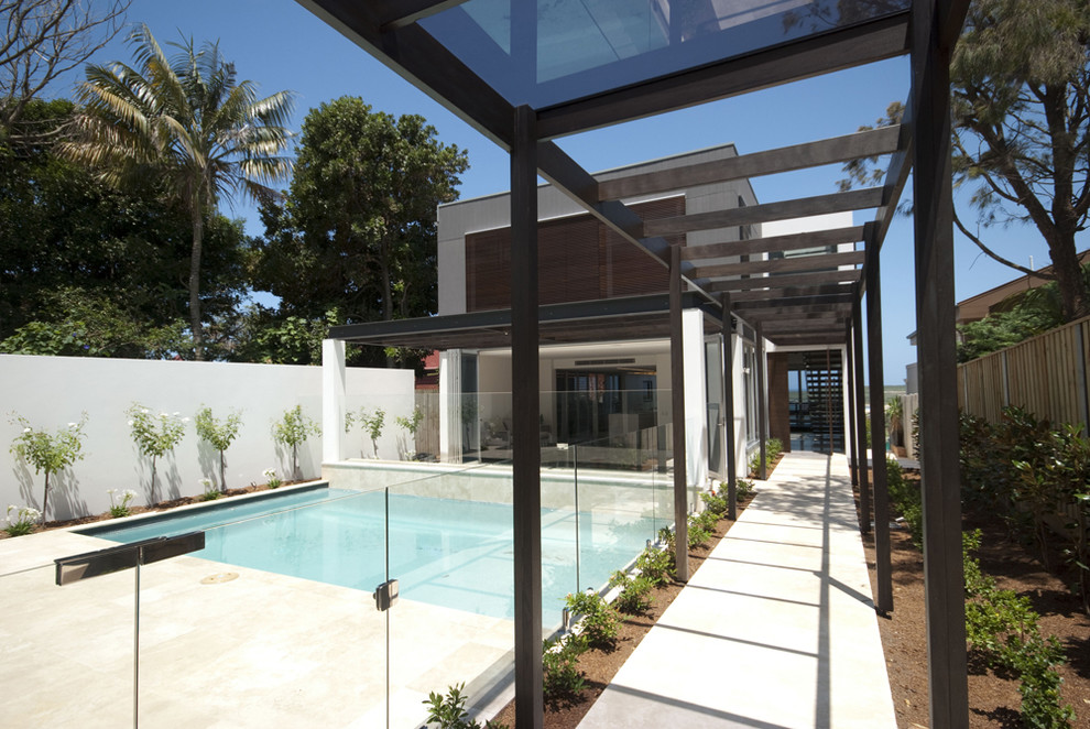 Inspiration for a modern wood exterior home remodel in Sydney