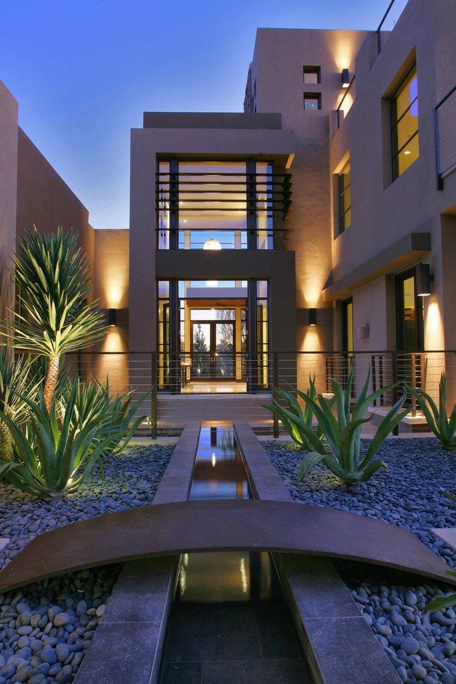 Example of a trendy three-story exterior home design in Las Vegas