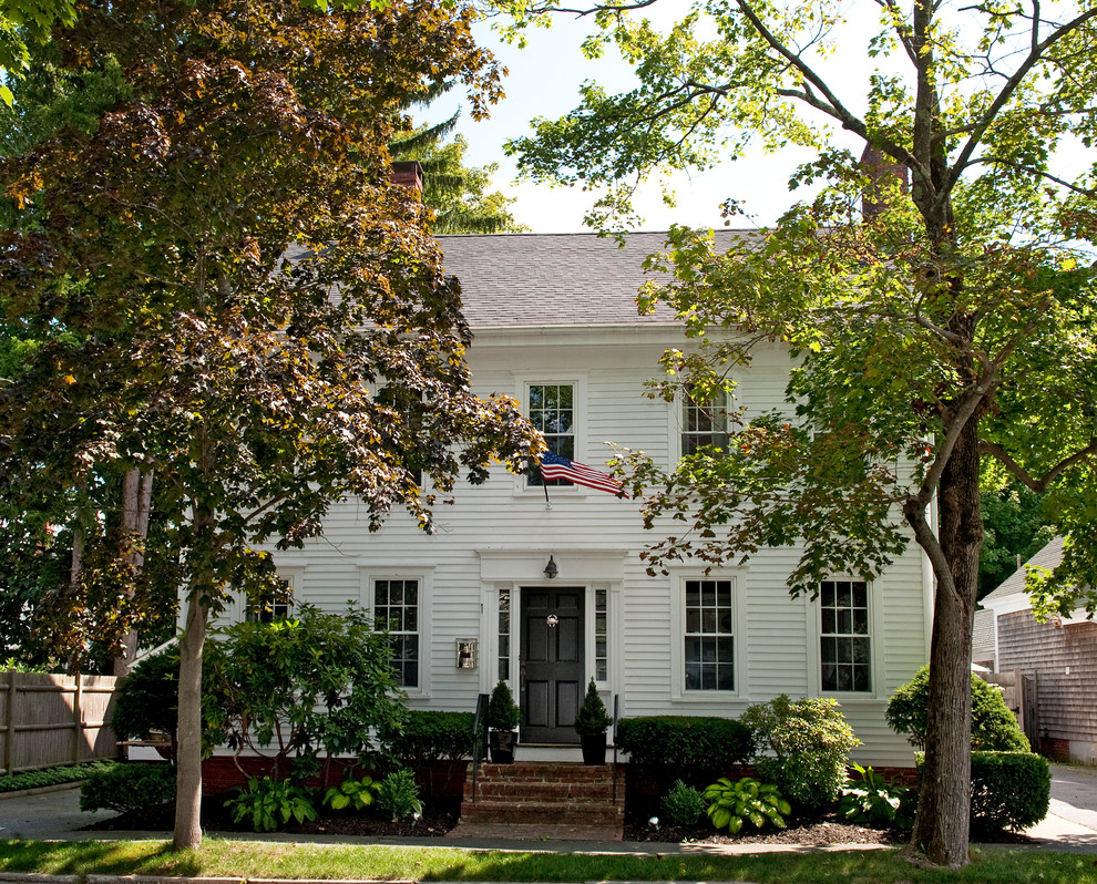 Inspiration for a mid-sized timeless white two-story wood exterior home remodel in Boston