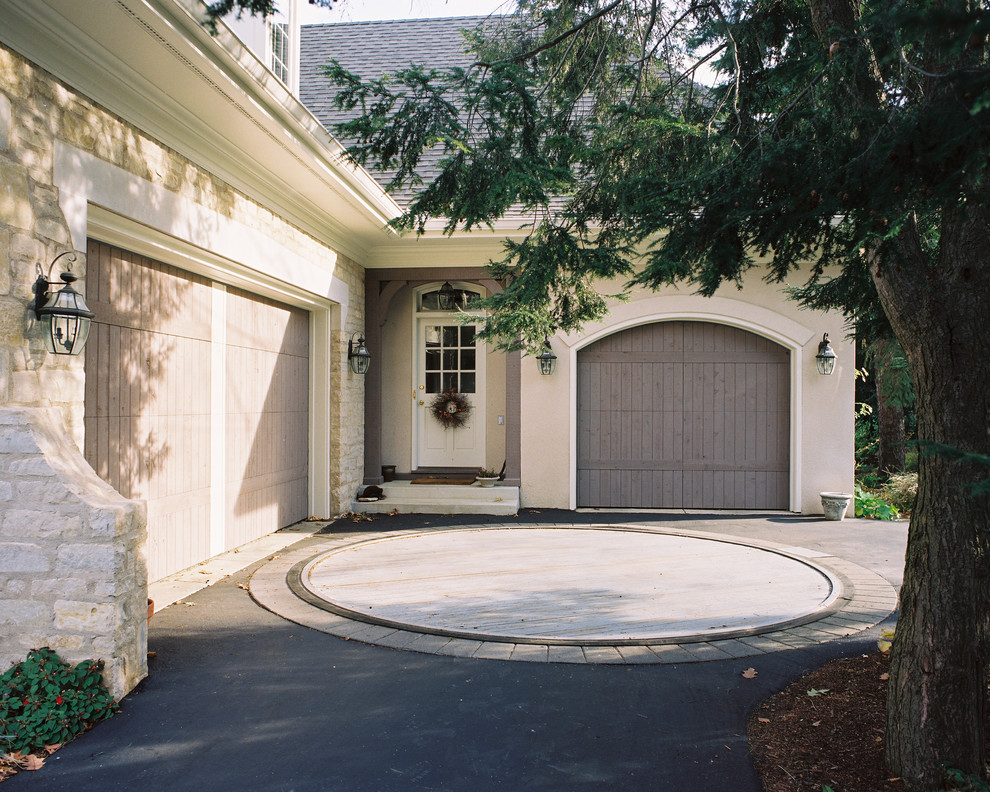 Example of a classic stone exterior home design in Columbus