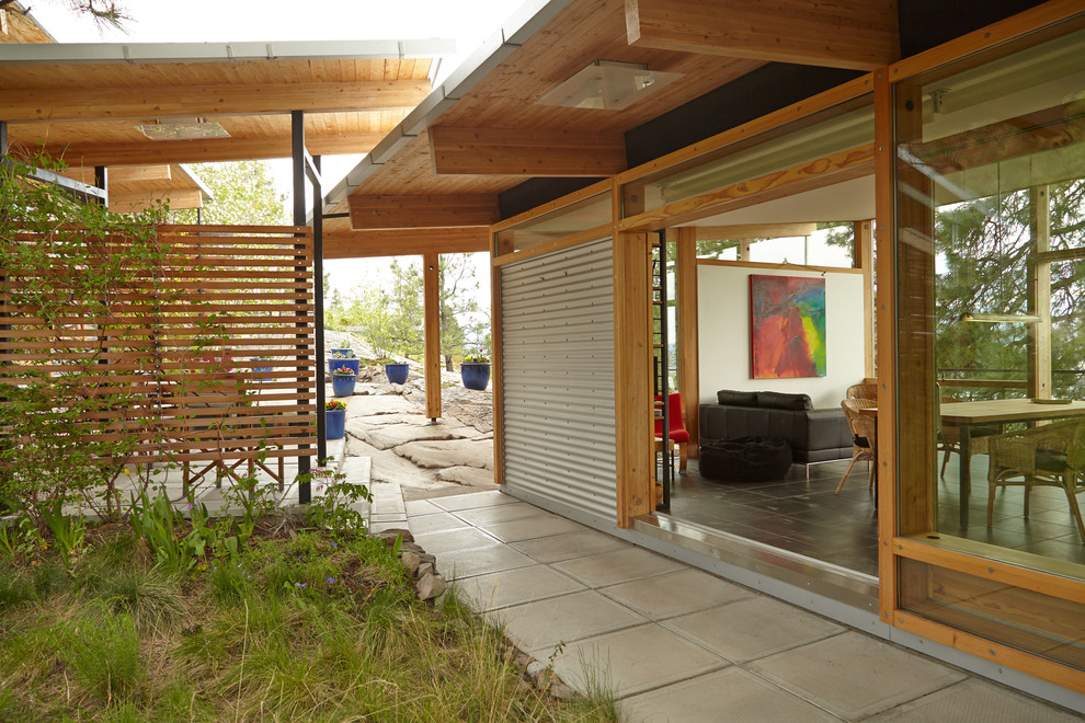 Example of an urban one-story metal exterior home design in Vancouver