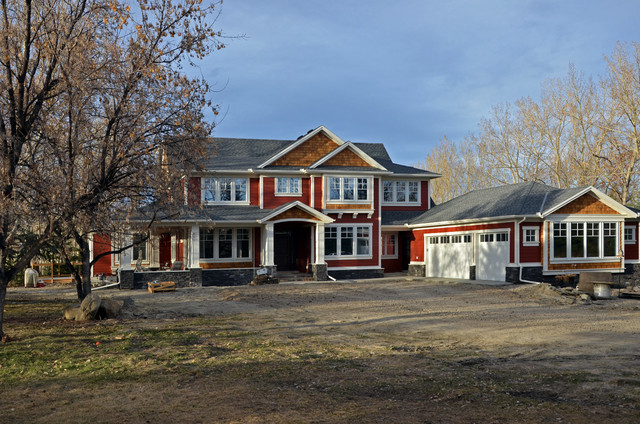 Inspiration for a mid-sized timeless red two-story wood exterior home remodel in Calgary