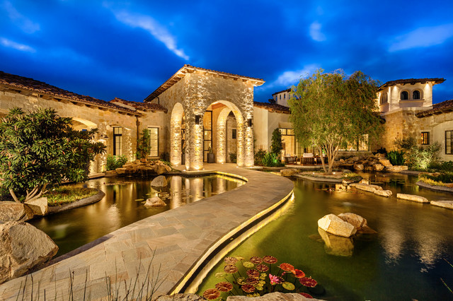 Inspiration for a mediterranean stone exterior home remodel in San Diego