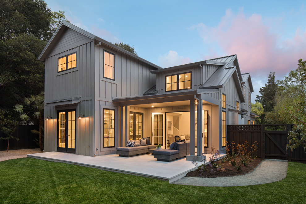 Example of a large country gray two-story wood and board and batten exterior home design in San Francisco with a metal roof