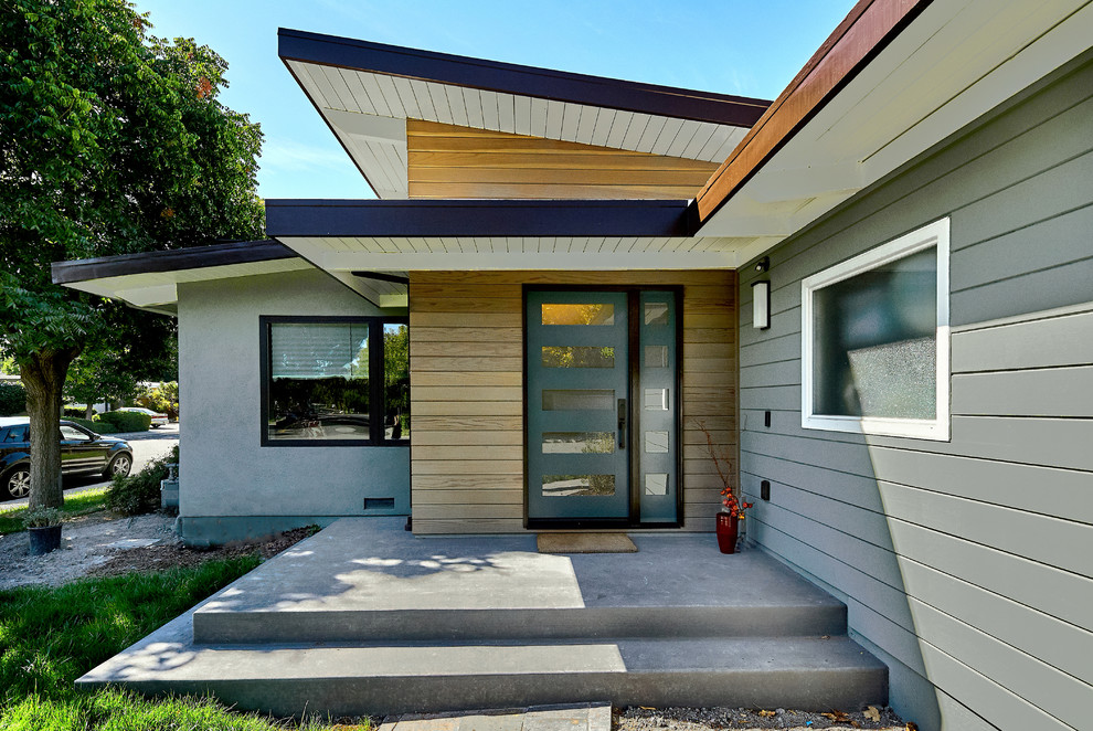 Inspiration for a mid-sized mid-century modern gray one-story mixed siding exterior home remodel in San Francisco