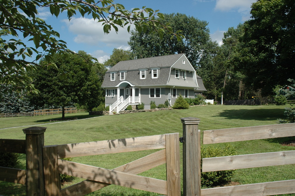 Inspiration for a country gray two-story wood exterior home remodel in New York with a gambrel roof