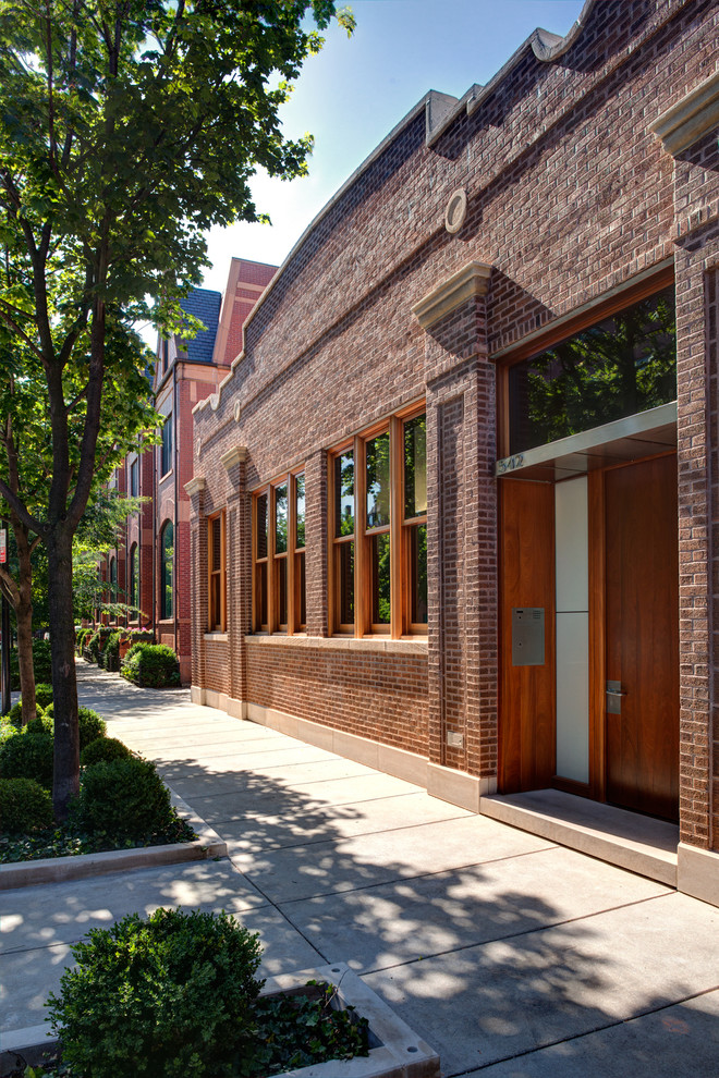 Example of an urban brick exterior home design in Chicago