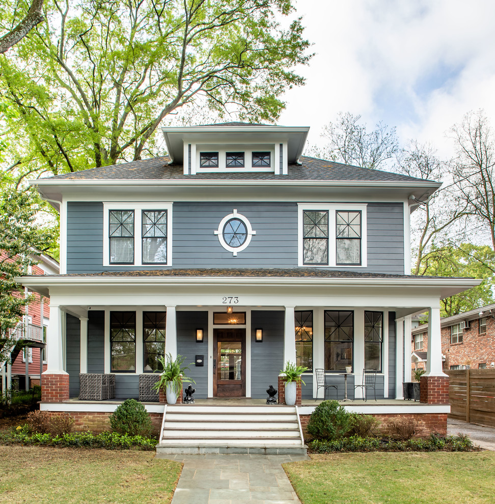 Elegant gray two-story house exterior photo in Atlanta with a hip roof and a shingle roof