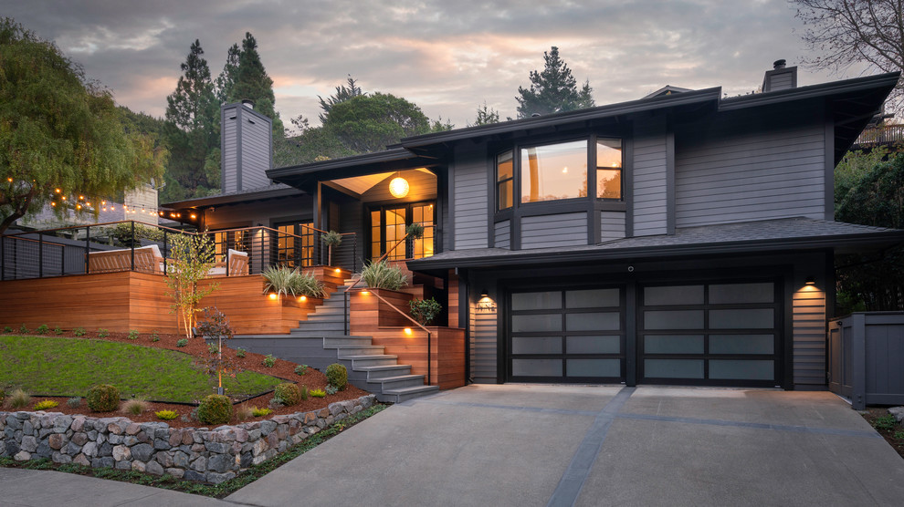 Example of a large trendy gray two-story wood house exterior design in San Francisco with a hip roof