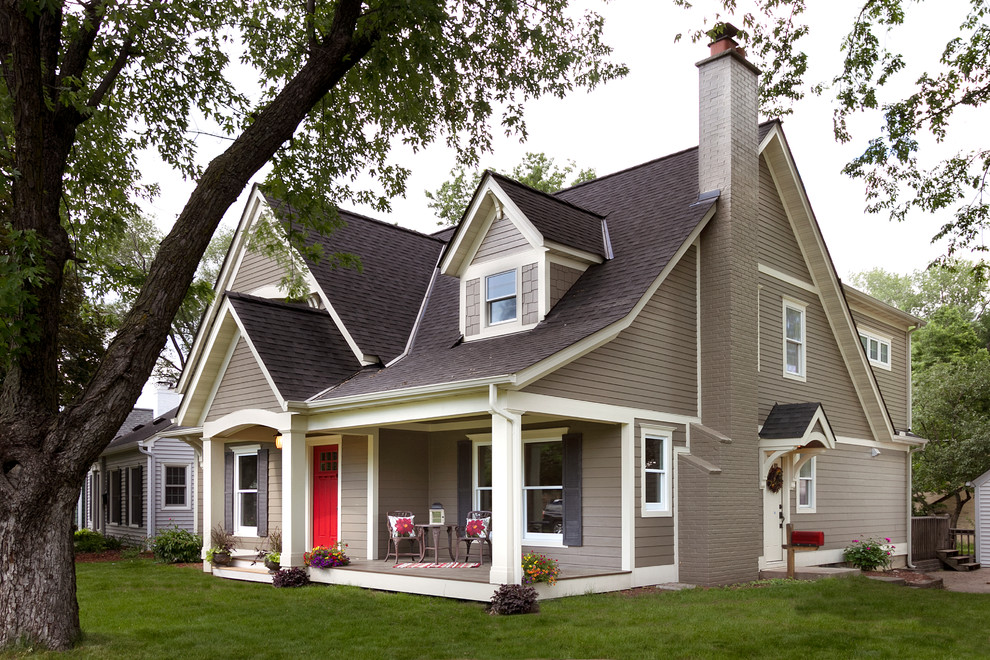 Example of a mid-sized classic brown exterior home design in Minneapolis