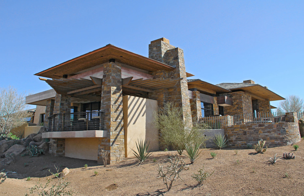 Example of a tuscan exterior home design in Phoenix