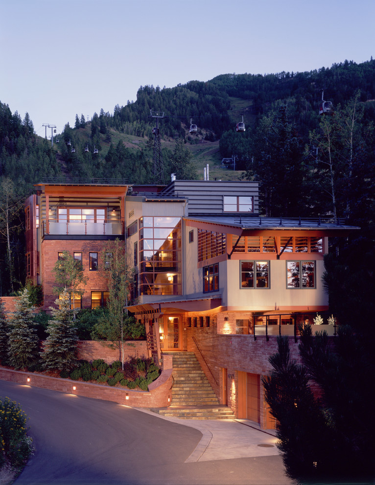 Large trendy beige two-story mixed siding house exterior photo in Denver