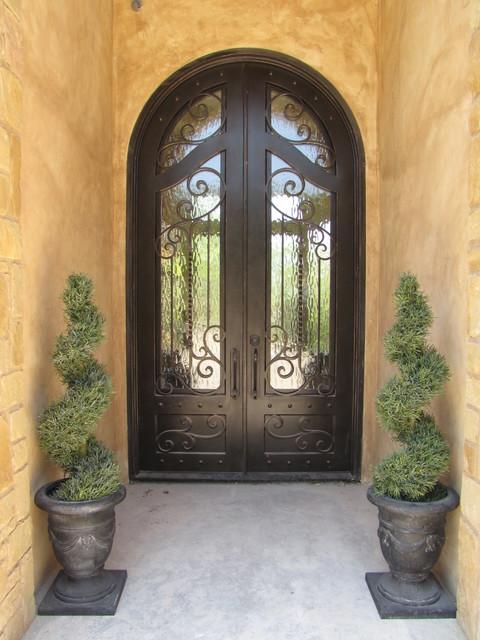Model home mediterranean exterior austin by river for Mediterranean style entry doors