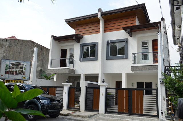 Modern asian duplex for Modern duplex house designs