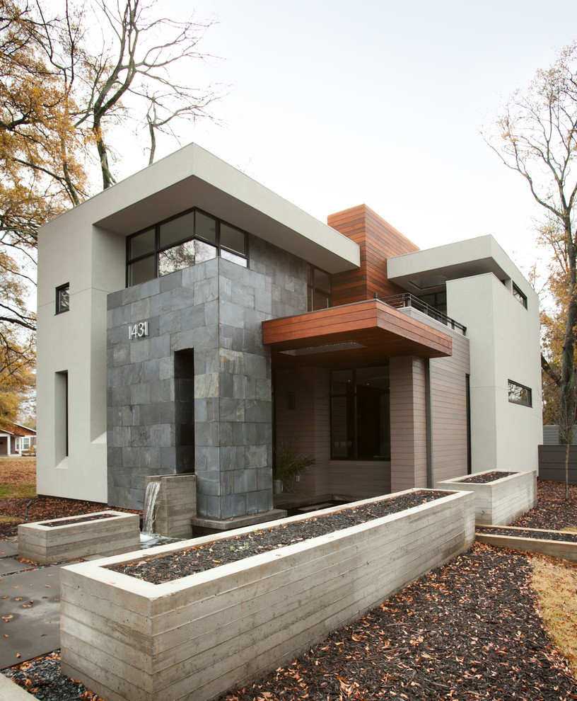 Inspiration for a mid-sized modern two-story mixed siding exterior home remodel in Atlanta